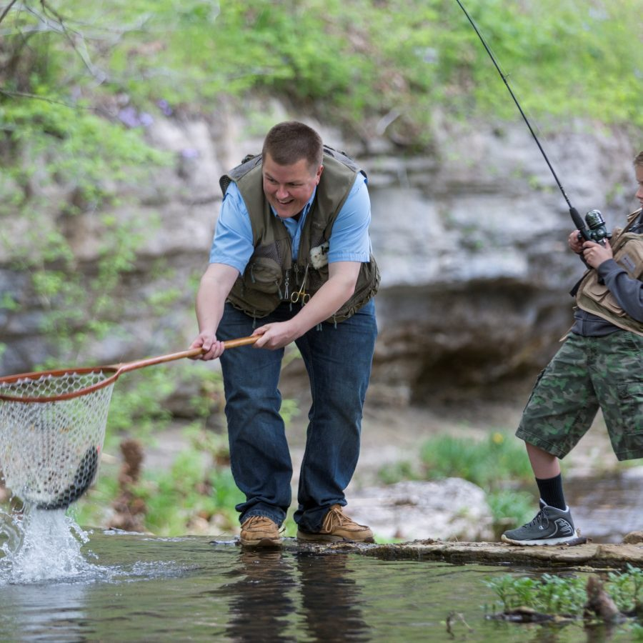 Big Cedar Lodge Father and son fishing for lunker trout in Dogwood Canyon